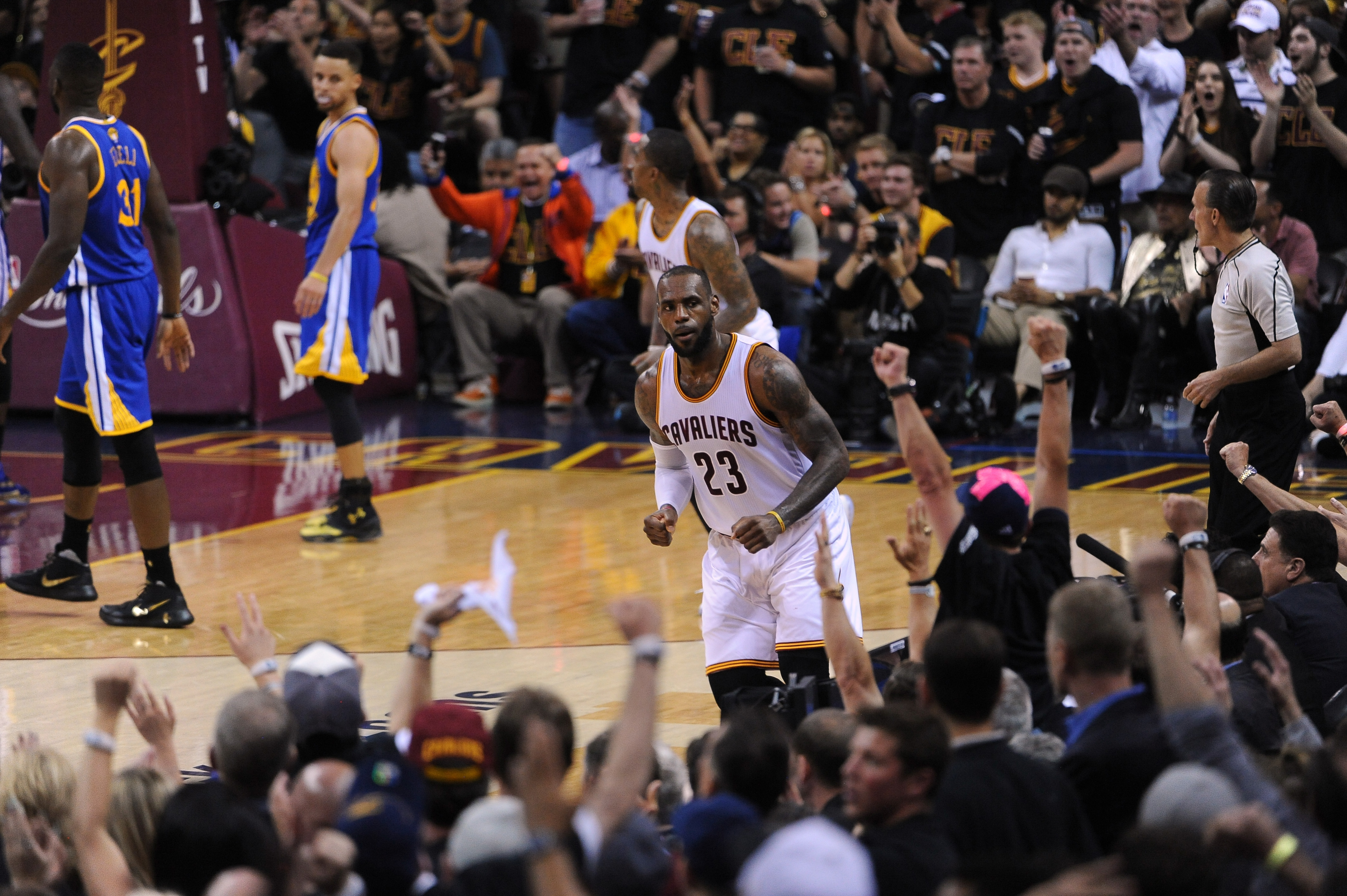 cd95955d93b JUNE 19 -LeBron James of the Cleveland Cavaliers celebrates after making a  shot during his team s game against the Golden State Warriors at Quicken  Loans ...