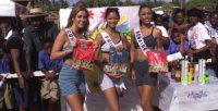 Arianna Bola–os, MISS COSTA RICA 1999, Miriam Quiambao, MISS PHILIPPINES 1999, and Julina Felida, MISS BONAIRE 1999 pose for pictures after the goat races while on Tobago preparing for the 48th annual Miss Universe Pageant.