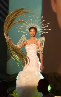 Miriam Quiambao, MISS PHILIPPINES 1999, pre-tapes the National Costume opening number May 23, 1999 featuring Delegates in costumes depicting native traditions from their country.