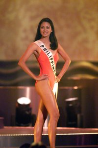 Miriam competes in Oscar de la Renta Swimwear as the preliminary competition is underway May 21,1999.