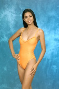 Miriam  gives a sneak peak of the Oscar de la Renta 'fun' swimsuit, the Official Swimwear Sponsor of the 1999 MISS UNIVERSE Pageant