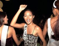 Miriam dances aboard a parade float on her way to a reception, May 16, 1999, at the home of Trinidad and Tobago's President Arthur Robinson.